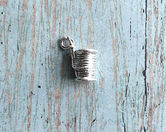 Small spool of thread with needle charm 3D silver plated pewter (1 pc) - sewing thread charm, silver spool pendant, seamstress charm, EE16