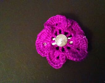 Purple ruffled flower with sparkle center