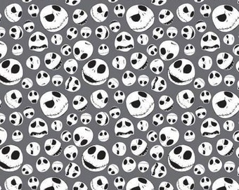 Nightmare Before Christmas Jack Faces on Iron Gray cotton fabric by Camelot Fabrics