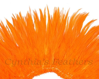 Wholesale 1/2 Yard, Strung Rooster Orange Saddle Feathers (5-7 inches in length) for Crafting, Sewing, Wedding, Decoration SKU: 7A52