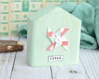 Light Green House with Pinwheel. Choose Your Word.