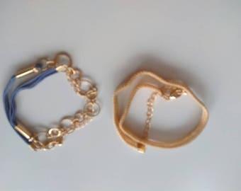 Two gold adjustable bracelets.