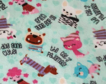 Cats and Dogs fleece dog pajama. Available in S, M or L.Sizes under item details box. Machine Washable and open. underneath for potty breaks