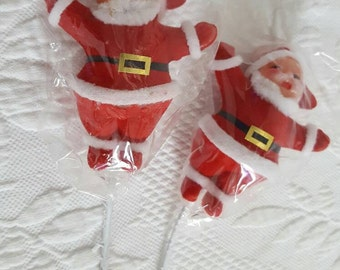 Vintage pair of old stock Flocked Santa Claus with attached stick