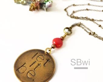 LET IT BE necklace. Hand stamped with coral details in bronze