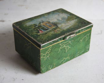 Vintage green tea can with landscape and gazebo