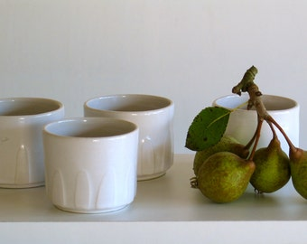 Ceramic Cup. Short goblet. Small white stoneware Cup decorated in relief. Espresso Cup.