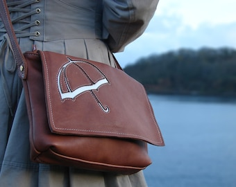 Tan satchel brolly bag