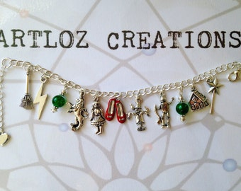Cute Wizard of Oz charm bracelet with Dorothy, ruby slippers, lion, scarecrow, tin man and more