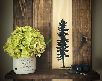 Rustic wood shelf with hand painted sitka tree design