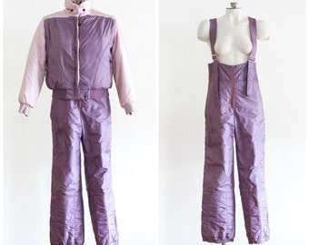 1980s pink and purple overall ski suit