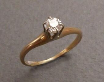 14K .20 pt diamond solitaire size 4.5