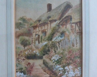 Framed original watercolour painting, probably late Victorian Edwardian with popular idyllic rural country scene, thatched cottage garden