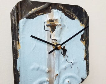 Splash of blue a vintage blue patinaed  ceiling tin tile clock.