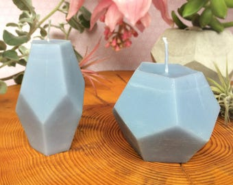 A pair of geometric candles in dove blue