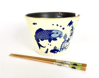Handmade noodle bowl with fish pho soup pottery