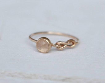 14 k yellow Gold Infinity Ring with Rose quartz