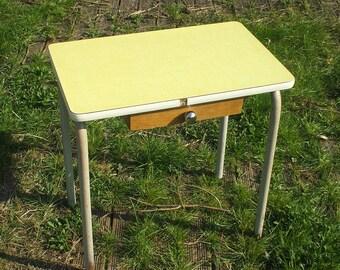 Schoolboy, yellow formica table