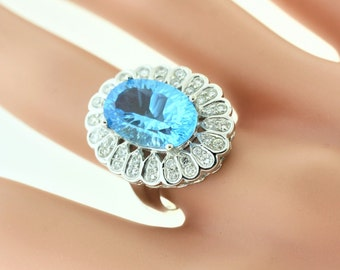 Oval Topaz And Diamond Halo Ring- 18k White Gold