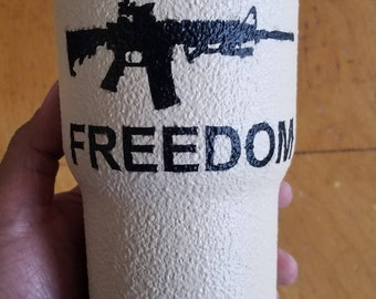 Desert sand Defend Freedom 30oz Rtic tumbler with texture grip