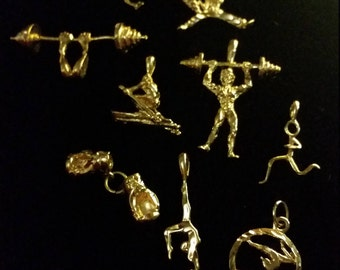 Gold Electroporated Charms Body Builder, karate, Skater, runner, boxing gloves, skier, gymnast. 1.50 each.