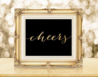 """PRINTABLE Art """"Cheers"""" New Years Eve Print Party Bar Table Sign Poster, Quote Wall Art, Black and Gold Hand Lettered Calligraphy Download"""