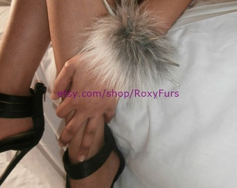 spiked leather wrist cuffs trimmed with fur