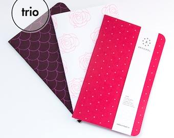 TRIO NOTEBOOKS / CARNETS