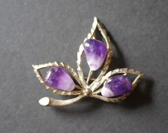 Leaf brooch with polished amethyst stones