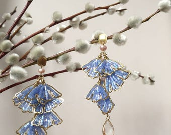 Ginkgo leaf statement earrings with fresh water pearls and glass beads. Brass earrings with silver studs. Nature inspired.