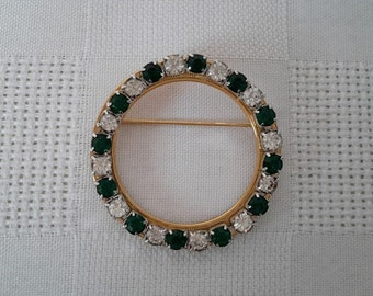 Round spindle mounted on gold, emerald green and clear rhinestones