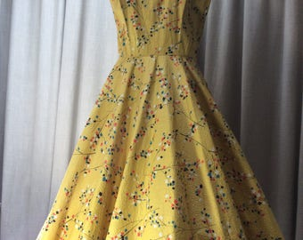 Stunning 1950's printed dress on textured cotton with diamonte trim.