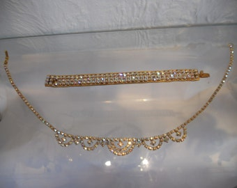 Gold coloured, necklace and bracelet, with sparkling stones