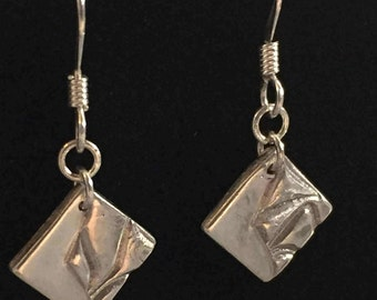 Part-textured fine silver earrings with sterling silver earwires and findings.