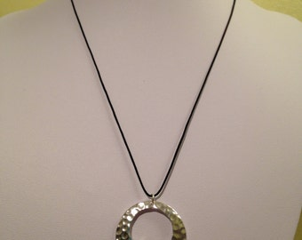 Modern Pendant featuring a Sterling Silver Hammered Effect Circular Pendant paired with a Black Cord Necklace