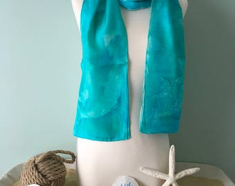 Silk scarf in turquoise with dolphins