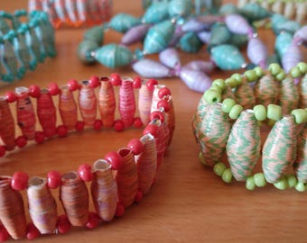 Assorted colours, thin, tapered, paper bead and seed bead, ladder stretchy bracelets.