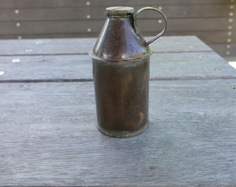 Antique oil tin with sealed lid and handle