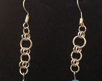 Silver and teal graduated dangle earrings