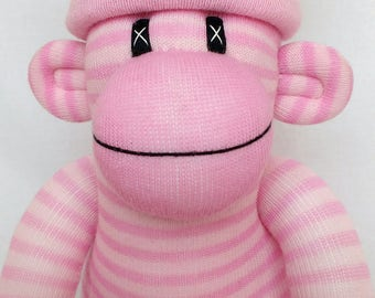 Pretty pink sock monkey with removable love heart pom pom hat