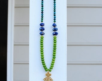 Gold Chrest Long Beaded Necklace