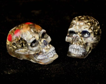 His and Her's Orgone Energy Skulls Her's has the cute Red Coral Flowers