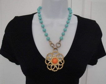 Vintage Graziano teal bead necklace, Flower Power gold tone 3 dimensional metal 2 and 1/4 inch pendant w/ orange center & clear rhinestones