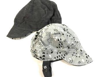 UB2 XOXO a gray chambray reverses to fun geo shapes and animals on this baby BOY newsboy sun hat, by The Urban Baby Bonnet (all sizes)