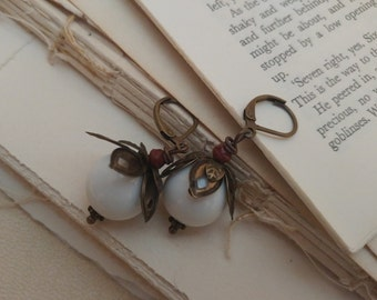 Flower bud earrings.