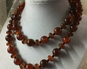 ON HOLD for doreenrussell3 Single Strand Rich Brown Tortoiseshell Like Lucite Bead Necklace 1960's