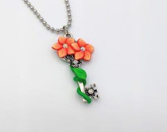 Orange Flower Key Pendant; 1.75 Inches Long; Silver-tone; Skeleton Key Pendant; Floral Blossom; Style: #ORF03