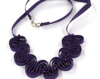 Purple ribbon necklace with sparkly beads
