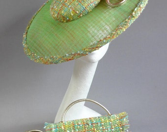 green and orange saucer hat sinamay with bouclé fabric with big orange flower on comb with matching bag