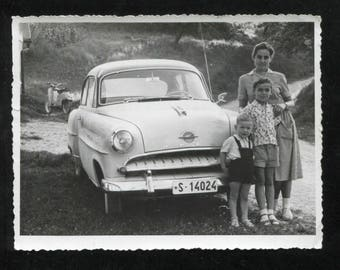 vintage snapshot Opel and backlit family with scooter 1959.  NOTE: shop holiday-ships September 1